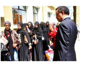 Dr.Tewodros with migrants photo